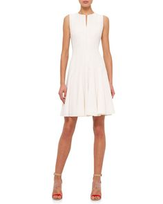Akris double-face wool dress. Split neckline; hidden front zip. Sleeveless; moderate shoulder coverage. Fit-and-flare silhouette. Nips at the natural waist. Straight hem. Wool/nylon. Imported.