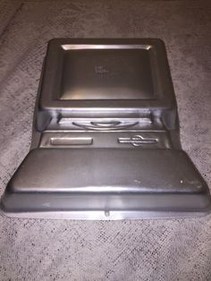 "New old stock Wilton computer cake pan 11"" x 13"", one dime size dent on bottom rim 