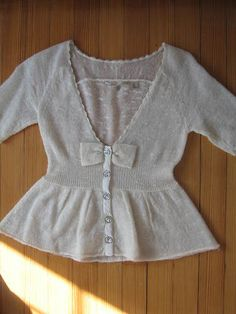 Anthropologie Knitted & Knotted peplum bow cardigan sweater