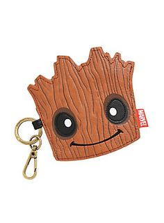 "<div>He is Groot. Bring Marvel's cute baby tree and your loose change together with this intergalactic purse. <i>Guardians of the Galaxy</i> has never looked more adorable than as this Loungefly bag. Zip-closure, key chain and lobster clasp.</div><div><br></div><ul><li style=""list-style-position: inside !important; list-style-type: disc !important"">PU</li><li style=""list-st..."