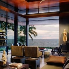 Ocean House is a tropical home in Hawaii inspired by traditional Balinese palaces and temples.