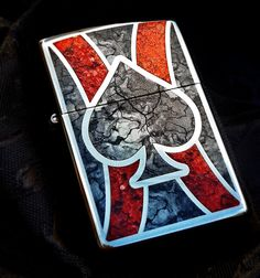 Zippo's newest customization, Fusion, creates a stained glass-style effect on this High Polish Chrome lighter featuring a spade design. Comes packaged in an environmentally friendly gift box.
