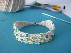 Free Crochet Pattern for Summer Cotton Crochet Beaded Bracelet. This is pretty cool how it connects the strands together to make one whole piece.