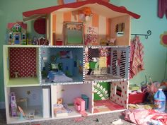 "DIY Barbie dollhouse, with ""wallpaper"" from fabric applied with starch."