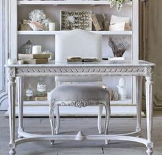 A gorgeous French-inspired piece for your front hall, or equally fabulous as a desk or vanity! In weathered Chipped White finish with gilt highlights, and white marble top. Dimensions: 29H x 47W x 28D
