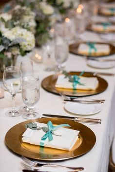 Teal and gold place settings