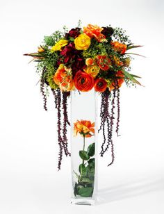 Michaels.com Wedding Department: Orange and Pink Centerpiece Save time and money when you create your own floral pieces for your wedding. This centerpiece is accented with roses, daisies and hydrangeas in bold, bright colors. Designed by Debbie Terrell