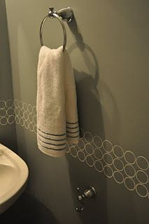 Awesome Idea!!  Using an empty toilet paper roll as a stencil.  I am so doing this on in our 1/2 bathroom.