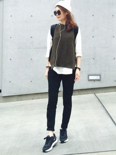gray sweater vest, white shirt, black jeans, sneakers