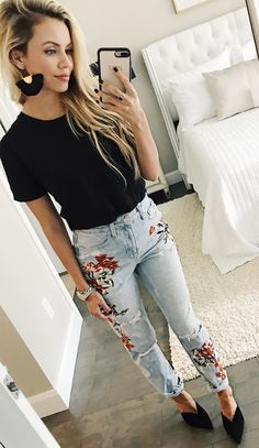 #fall #outfits women's black crew-neck T-shirt and washed blue and red floral denim skinny jeans
