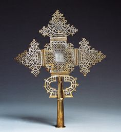 Africa | Processional hand cross from Ethiopia | Silver | 19th century | Length 42cm