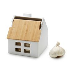 This ceramic cottage is great for storing garlic.