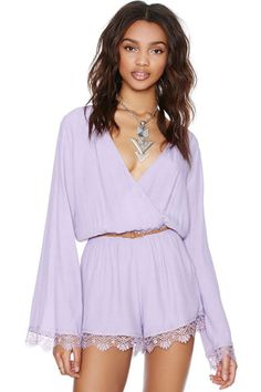 This lilac romper is perfect for those days you want to look totally amazing, but only have a few minutes to get ready! It features a delica...