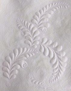 Diane Loomis' Free Motion Quilting Challenge for Feb-love the rogue feather at the bottom.