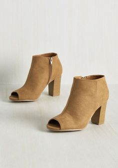 Keep on Chic-ing on Bootie. When the going gets rough, the stylish get going in these tawny brown heels. #tan #modcloth