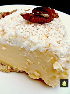 TROPICAL COCONUT PIE! It is so creamy and has a rich coconut flavor, laced throughout with juicy pineapple chunks and a crispy pecan crust.