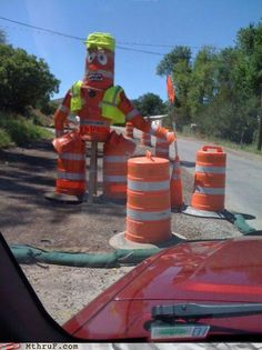 This is why road construction takes soooooo long. One guy does all of the road work and this is what the ten other guys standing around do.