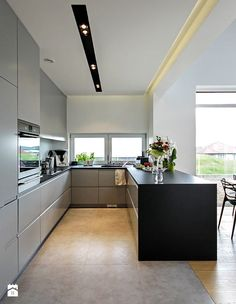 A modern C-shape kitchen looks great when there isnt enough room for a floating island