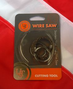 """Wire Saw stainless survival tools emergency tactical spearfishing gear equip UST #UST  Wire Saw  Perfect pocket sized cutting tool  20""""  stainless-steel, single-strand cutting wire Finger holes for easy handling Lightweight and coils for easy storage Overall Length: 23"""" (584mm) Weight: 0.8 oz. (22g) Keep in your car for winter driving hazards, bug out bag, emergency use Camping, hiking  To use: Wrap wire saw around the branch Using the rings on each end pull from side to side"""