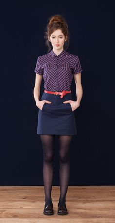 Checkered blouse, navy skirt, red belt, black tights, flat shoes