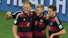 Germany's forward Andre Schuerrle (C) celebrates with Germany's defender Benedikt Hoewedes and Germany's midfielder Julian Draxler