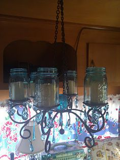 Camper chandelier - I hope those are the battery operated candles!