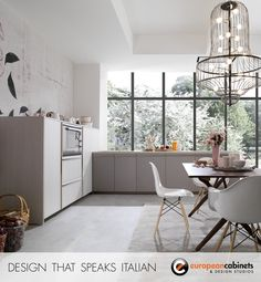 Light grey wood kitchen cabinets from the Beluga collection by famed designer Ferruccio Laviani.