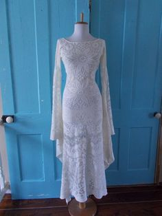 I'd alter the sleeves but...hot dang! Vintage 1960s 1970s Long Off White Crochet LACE  Angel Bell Sleeve HIPPIE Wedding Maxi Dress. $174.99, via Etsy.