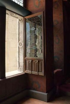 France: lovely window detailing-leaded glass set in ornate wood frame. What craftsmanship and artistry.