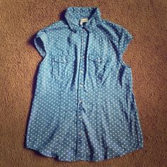 Sleeveless heart pattern collared button up shirt Good condition. Barely worn. No rips, tears, or stains. Goes great over a white long sleeved sweater. Size large but fits like a M/L. Accepting reasonable offers, please use button. Tops Button Down Shirts