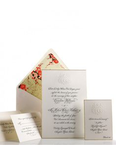 A custom-created family crest embellishes this invitation using inkless engraving. Bell'Invito
