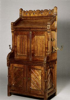 Secrétaire-Cabinet, design attributed to Bruce James Talbert. Manufactured by Holland & Sons. c. 1870. Oak with harewood and satinwood inlays, with original hardware. No. 8, H. Blairman & Sons, 2011