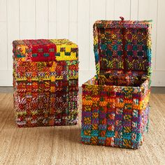 "one of a kind multicheck woven storage boxes, set of 2    Keep storage in check with our colorful handwoven boxes. They're made of recycled cotton cloth artfully woven on iron frames and are perfect for home or office. Each is one of a kind. Imported. Set of two, includes a small and large box. Small box; 13""sq. x 18""H, Large box; 16""sq. x 20""H."