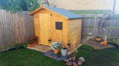 """Ania's shed fits in wonderfully with the rest of her garden - here's what Ania had to say: """"Lovely little shed - very pleased with the purchase!"""""""