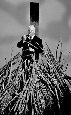 Alfred Hitchcock always loved to send himself up or his genre of films in photos. (please follow minkshmink on pinterest)