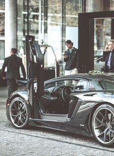 Lamborghini Aventador..owner is guy with the cap!;)