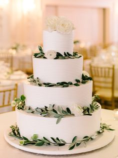 Four tier eucalyptus wrapped wedding cake: http://www.stylemepretty.com/2016/09/25/handwritten-notes-served-as-escort-cards-for-their-300-guests/ Photography: Michelle Lange - http://www.loveandbemarried.com/