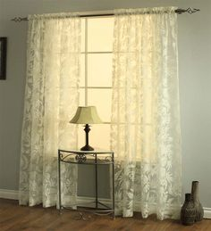 a beautiful floral leaf motif pattern on an ivory semisheer fabric infuses our leaves burnout - Sheer Curtain Panels