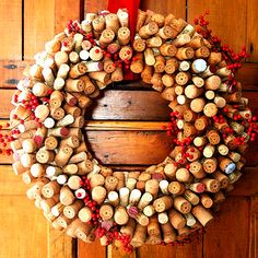Who wouldn't want to recreate this quirky cork Christmas wreath? For more Christmas decorating ideas visit goodhousekeeping.co.uk/christmas