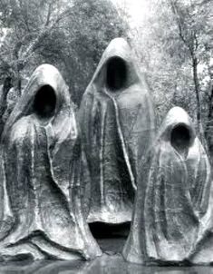 Creepy cemetery art from Salzburg, Austria. This trio of faceless mourning figures are strangely menacing.