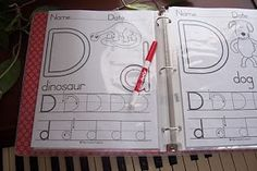 Alphabet worksheets in sheet protectors with dry erase markers.