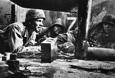 German infantrymen take cover in a house in southern Italy, on February 6, 1944, awaiting the word to attack after Stukas had done their work.