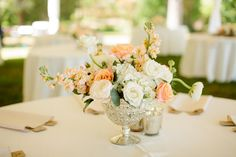 Comments from Studio Emme:  A simple mixed arrangement of hydrangea, stock, roses and ranunculus paired with mercury glass votives.  Budget $$ (without the ranunculus) // Photography:  Tucker Images - www.tuckerimages.com