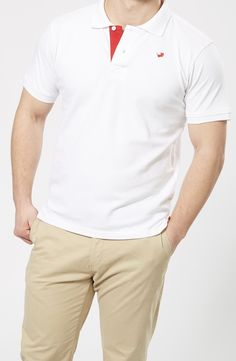 FARU Classic White Polo  10% of all sales goes to animal conservation.