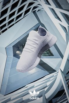 Deerupt is disruptively simple proof that minimalism can be bold. The ultra-flexible mesh upper of these men's shoes is covered in a layer of stretch grid webbing, and a web-wrapped EVA midsole echoes the geometric look. Learn more at adidas.com today.