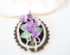 This beautiful crochet set was created with cotton embroidery thread by very thin crochet hook (0.5mm).  Flowers have a color from light mustard in the middle to deep lilac on the edge. The middle of the flowers embroidered by Japanese seed beads (24kt gold).  Reverse side of every petal and leaf is coated with non-toxic special tool for rigidity and durability.  All materials, used for this magnificent set are high quality.  Dimension of pendant: 4,5cm/1,77inches Length of pendant: 11cm...