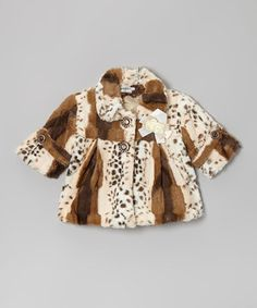 When the curtain rises, this stylish faux fur coat will steal the spotlight. Steeped in plush, luxurious comfort and lined with a satiny interior, this funky, furry piece also has extras like jeweled buttons and a rose at the lapel.