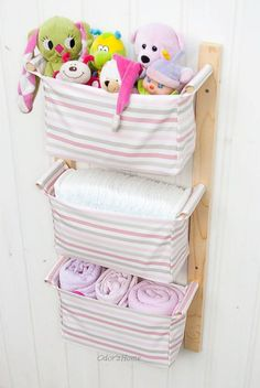 Hanging nursery storage - with 3 fabric baskets / boxes - IKEA Emmie Rand in pink - diaper caddy, organizing by OdorsHome on Etsy https://www.etsy.com/listing/97603534/hanging-nursery-storage-with-3-fabric