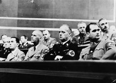 Rudolf Hess (1896 - 1987): Hess with other Nazi Ministers listening to a speech by Hitler. From left to right; Baron von Neurath (President of the Cabinet Council), Dr Goebbels (Propaganda), Dr Frick (Interior Minister), von Ribbentrop (Foreign Minister) and Hess.