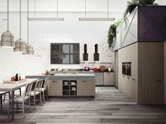 "Loft is the expression of the latest ""urban"" trends; a modern kitchen design that fulfills the desire for the raw beauty of wood, metal and glass as well as compact furniture with a vintage, industrial look that gives strong character to open floorplan spaces."
